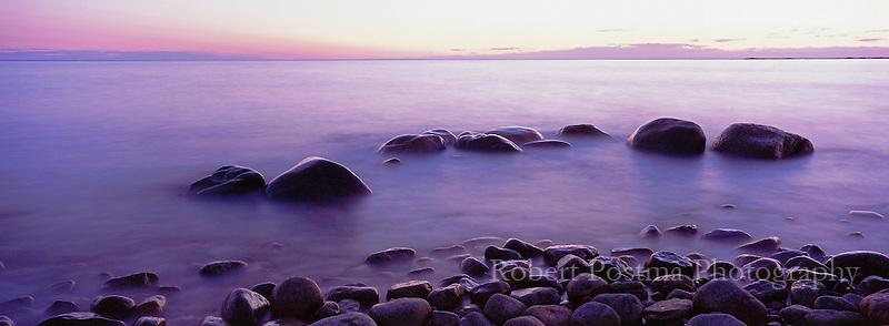 Sunset over the ocean, Green Point, Gros Morne National Park, Newfoundland, Canada.