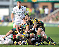Northampton, England. Kahn Fotuali'i of Northampton Saints clears the ball during the Northampton Saints and Leicester Tigers  during the Aviva Premiership match at Franklin's Gardens, Northampton, England on March 29, 2014