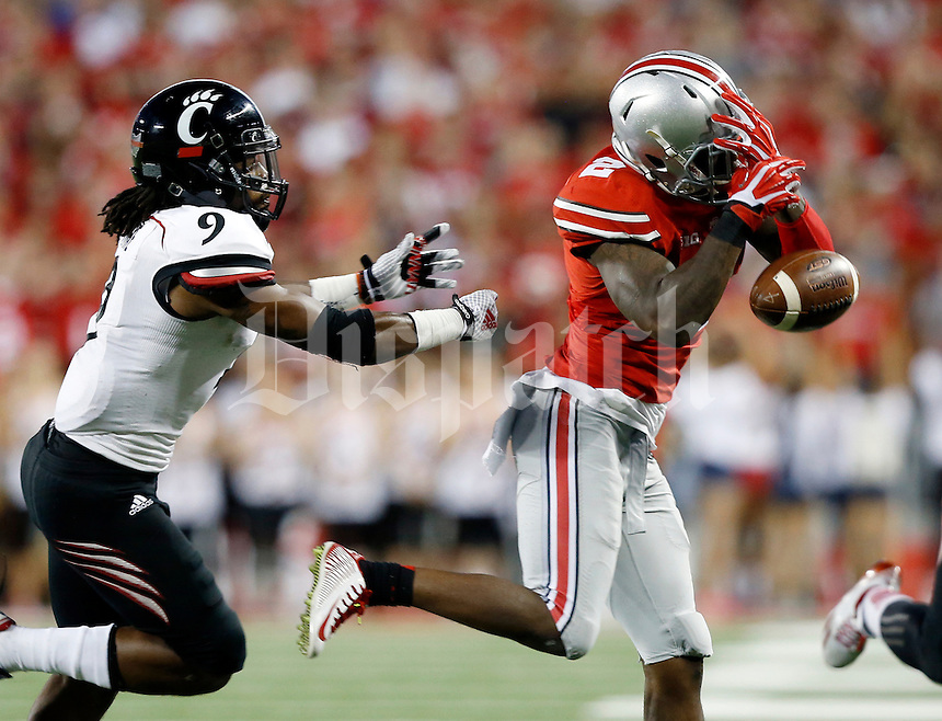 Ohio State Buckeyes running back Dontre Wilson (2) drops a pass in front of Cincinnati Bearcats cornerback Leviticus Payne (9) during the second quarter of the NCAA football game at Ohio Stadium in Columbus on Sept. 27, 2014. (Adam Cairns / The Columbus Dispatch)