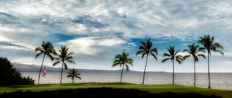 Sailboat and Hilton Waikoloa Beach Golf Resort. Hawaii, The Big Island
