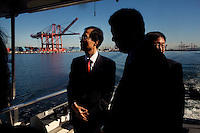 CREDIT: Daryl Peveto / LUCEO for The Wall Street Journal.Assignment: 10113  Slug: KORDEAL..Long Beach, California, January 24, 2011 - Han Duk-soo (left), South Korea's Ambassador to the United States during a tour of the Port of Long Beach along with Chamber of Commerce representatives, South Korean advisors and local businessmen. The delegation was in town as part of a sustained effort since 2007 to sell the idea of the U.S.-Korea Free Trade Agreement to the US. Final language is still being worked out, but the agreement could come to a vote in the next few weeks. ..The U.S.-Korea Free Trade Agreement would eliminate tariffs on 95% of U.S. goods within five years of its signing and could boost U.S. exports by $11 billion annually, the International Trade Commission estimates. It would also reduce trade restrictions and tariffs on U.S. auto and beef exports while continuing American tariffs on South Korean autos for a limited time. Southern California would almost certainly be a major beneficiary. Nearly $16 billion in goods moved between South Korean and Southland ports in 2009. The Los Angeles area is home to an estimated 600,000 Korean Americans, many of whom have strong business ties to their homeland and are heavily invested in the local economy. Southern California's entertainment industry also supports the pact, which would clamp down on unauthorized copying and sharing of music and videos in South Korea, where piracy is a serious problem..