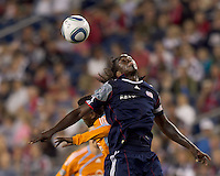 New England Revolution midfielder Shalrie Joseph (21) heads the ball. The New England Revolution defeated Houston Dynamo, 1-0, at Gillette Stadium on August 14, 2010.
