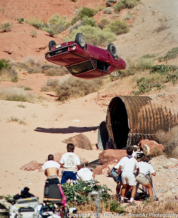 A mustang flies through the air while a camera crew films the crash at Valley of Fire state park in Nevada.