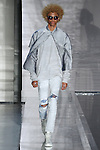 Model walks runway in an outfit from the John Elliott Spring Summer 2017 men's collection at Skylight Clarkson Square on July 13 2016, during New York Men's Fashion Week Spring Summer 2017.