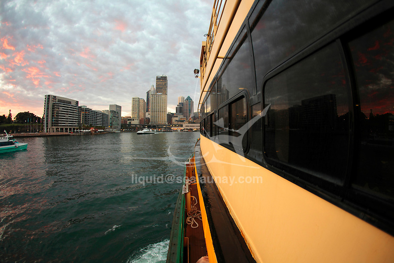 Onboard a Sydney Ferry arriving from Manly at Circular Quay early in a cloudy morning.
