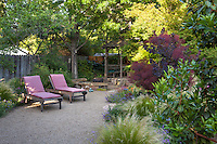 Lounge chairs on secluded bocce ball court in Habets garden, Pleasant Hill