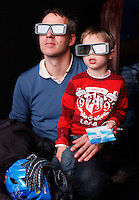 Father and son watch 3D film about water in Forum exhibition Hall, the site of the Bright Green Conference. United Nations Climate Change Conference (COP15) was held at Bella Center in Copenhagen from the 7th to the 18th of December, 2009. A great deal of groups tried to voice their opinion and promote their cause in various ways. The conference and demonstrations was covered by thousands of photographers and journalists from all over the world...©Fredrik Naumann/Felix Features.