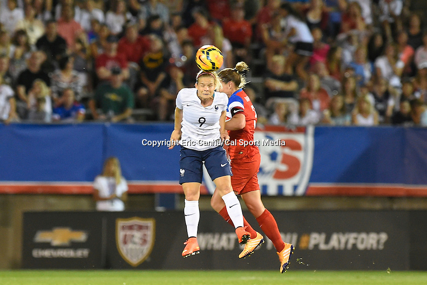 June 19, 2014 - East Hartford, Conn. U.S. - France's Eugenie Le Sommer (9) heads the ball during the USA Women's Soccer friendly game between USA and France held at Rentschler Field in East Hartford Connecticut. The match ended with a 2-2 tied score. Eric Canha/CSM