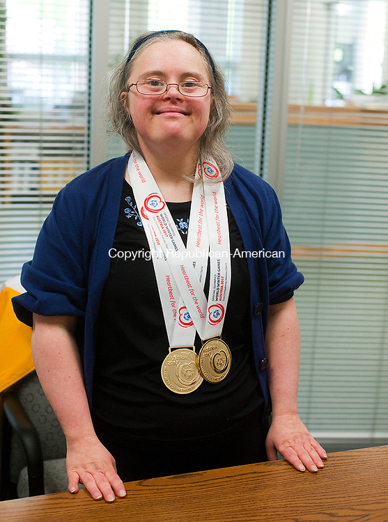 TORRINGTON,  CT-051017JS12- Special Olympian Natasha Cole, shows off her medals she won during the Special Olympics World Wintergames 2017 in Austria during an interview Wednesday at LARC in Torrington. Fellow athlete Rebecca Lamoin, who also competed was there to talk about her experiences as well. Jim Shannon Republican-American