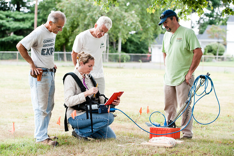 MIDDLETOWN, CT-21 August 2014-082114EC01-  Connecticut's first state archaeologist, Nick Bellantoni (far left), works on one of his last official projects with the state. A small team is using ground penetrating radar to determine how many unmarked graves are buried at Old Farm Hill Cemetery in Middletown. From L to R: Bellantoni, Deborah Surabian with the U.S. Department of Agriculture, Jim Trocchi and Scott Brady with Friends of the Office of State Archaeology. For 27 years, Bellantoni has worked on excavation cases across the world. He is retiring next month. Erin Covey Republican-American