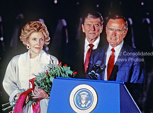 United States Vice President George H.W. Bush, right, introduces U.S. President Ronald Reagan, center, at a ceremony at Andrews Air Force Base, just outside of Washington, D.C. following the President's return from the Moscow Summit on June 3, 1988. First lady Nancy Reagan is at left..Credit: Arnie Sachs / CNP
