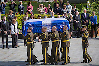 The casket of former Quebec premier Jacques Parizeau arrives before lying in state at the National Assembly in Quebec City on Sunday June 7, 2015.