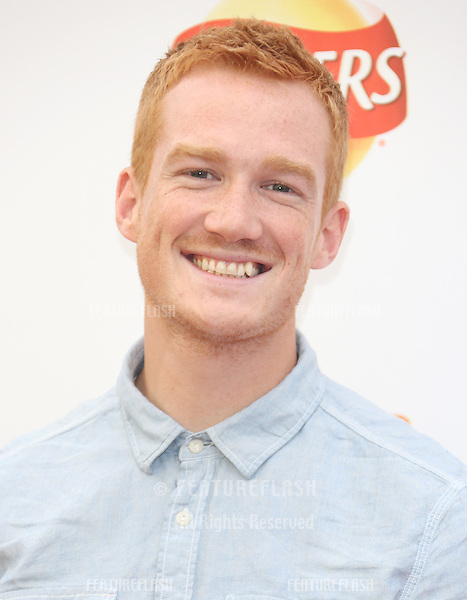 Greg Rutherford attending the Walker's Deep Ridged Crisps - Britain's tallest climbing wall challenge - Photocall, held at the Old Truman Brewery, London. 29/08/2012 Picture by: Henry Harris / Featureflash