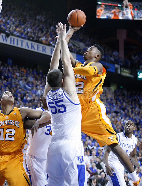 Scotty Hopson shoots against Josh Harrellson at Rupp Arena on Tuesday, February 8, 2011.  Photo by Latara Appleby | Staff