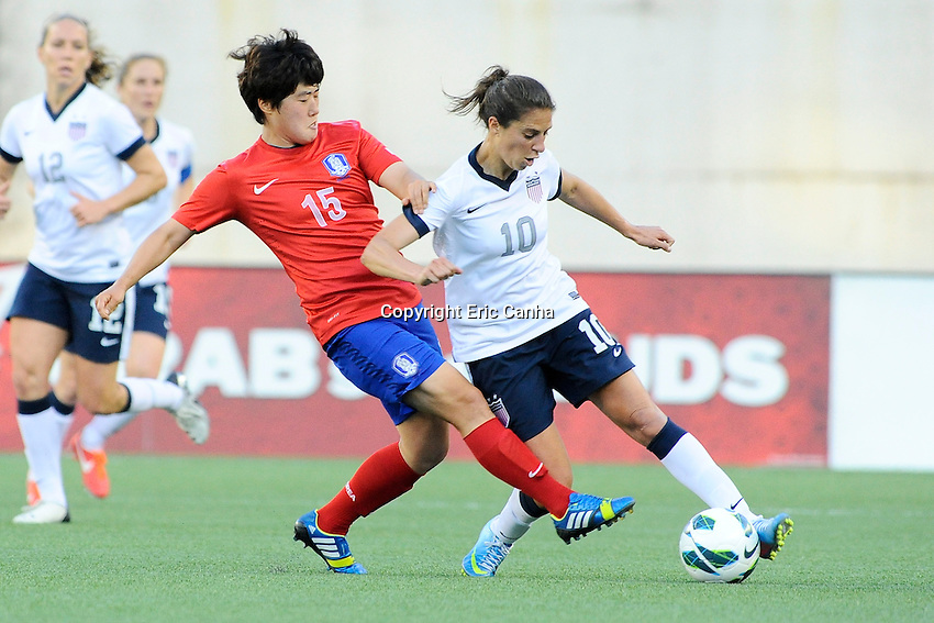 Korea Republic midfielder Kim Narae (15) and US Womens National midfielder Carli Lloyd (10) in action during the International Friendly soccer match between the USA Women's National team and the Korea Republic Women's Team held at Gillette Stadium in Foxborough Massachusetts.   Eric Canha/CSM