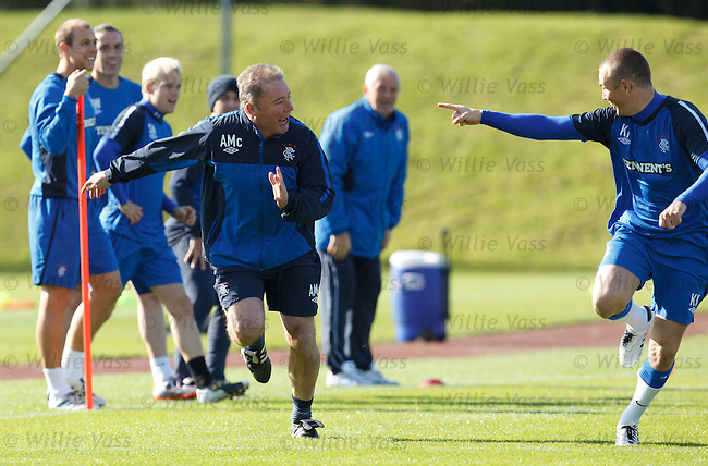 Ally McCoist gets a jump start and beats Kenny Miller much to his chagrin