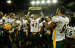 BROOKINGS, SD - OCTOBER 3:  MJ Stumpf #41 from North Dakota State hoists the Dakota Marker after the Bison beat South Dakota State 28-7 Saturday night at Coughlin Alumni Stadium in Brookings. (Photo by Dave Eggen/Inertia)