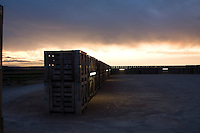 The car park of the Hotel Aire de Bardenas is enclosed by stacks of fruit boxes creating an ecological fence