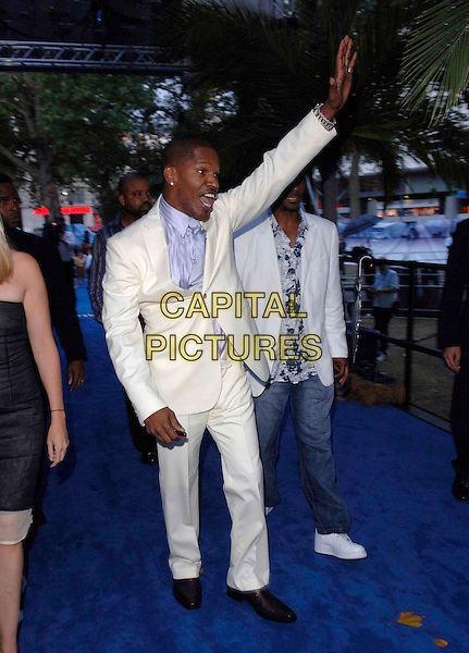 "JAMIE FOXX.European film premiere""Miami Vice"".Odeon cinema Leicester Square.27th July 2006 in London, England.Ref: FIN.full length white suit waving.www.capitalpictures.com.sales@capitalpictures.com.©Steve Finn/Capital Pictures."