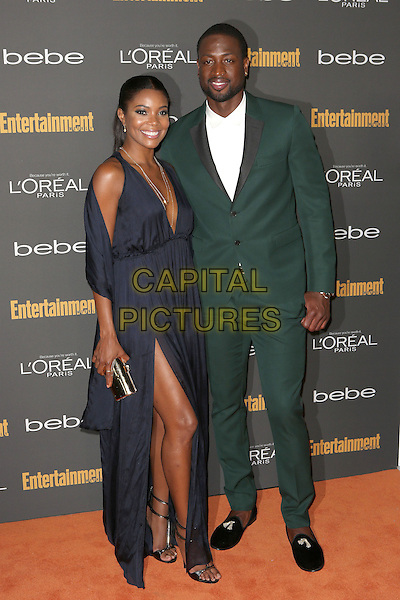 Gabrielle Union and Dwyane Wade<br /> 2013 Entertainment Weekly Pre-Emmy Party held at Fig &amp; Olive Melrose Place, West Hollywood, California, USA, <br /> 20th September 2013.<br /> full length black dress slit split  green suit white shirt <br /> CAP/ADM/MPI<br /> &copy;MediaPunch Inc./AdMedia/Capital Pictures