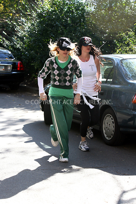 WWW.ACEPIXS.COM . . .  ....November 01 2006, New York City....Pop star Madonna took a jog through Central Park with her personal trainer on a warm and sunny November morning. After about an hour of constant running she returned to her apartment looking in great shape.....Please byline: PHILIP VAUGHAN - ACEPIXS.COM.. *** ***  ..Ace Pictures, Inc:  ..(212) 243-8787..e-mail: info@acepixs.com..web: http://www.acepixs.com