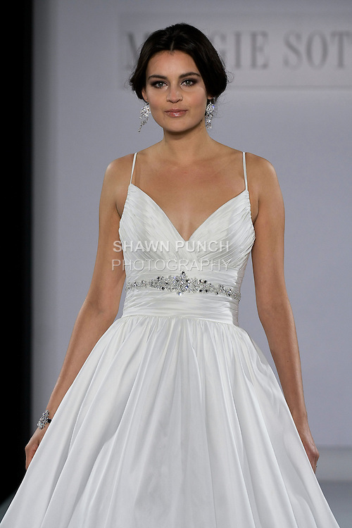 Model walks runway in a Stephanie wedding dress from the Maggie Sottero Spring 2013 collection, at The Couture Show, during New York Bridal Fashion Week, on October 14, 2012.