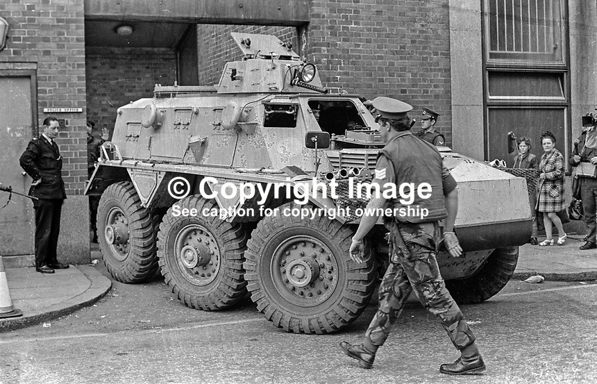 Crumlin Rd Jail escapee Martin Meehan arrives  Belfast court in Army personnel carrier. After escaping from jail and a period in the Rep of Ireland, he returned to Northern Ireland, where he was arrested on 9 Aug 1972. Charged with escaping from lawful custody he successfully argued that under the Special Powers Act a British soldier had no power of arrest and as such was awarded &pound;800 in compensation for being illegally detained for2 3 days, and the government were forced to amend the Special Powers Act to legalise the detention of others held under the Act. He was also charged with IRA membership and received 3 year sentence to become the first person to be convicted of the offence. He was imprisoned in Long Kesh, and released on 4 October 1974. Flg his sentence he was interned without trial. He was the last internee to be released after internment had been abolished. 197208000514<br /> <br /> Copyright Image from Victor Patterson, 54 Dorchester Park, <br /> Belfast, UK, BT9 6RJ<br /> <br /> t1: +44 28 9066 1296 <br /> t2: +44 28 9002 2446<br /> m: +44 7802 353836<br /> <br /> e1: victorpatterson@me.com<br /> e2: victorpatterson@gmail.com<br /> www.victorpatterson.com<br /> <br /> Please see my Terms and Conditions of Use at www.victorpatterson.com. It is IMPORTANT that you familiarise yourself with them.<br /> <br /> Images used on the Internet must be visibly watermarked i.e. &copy; Victor Patterson<br /> within the body of the image and copyright metadata must not be deleted. Images <br /> used on the Internet have a size restriction of 4kbs and will be chargeable at current<br />  NUJ rates unless agreed otherwise.<br /> <br /> This image is only available for the use of the download recipient i.e. television station, newspaper, magazine, book publisher, etc, and must not be passed on to any third <br /> party. It is also downloaded on condition that each and every usage is notified within 7 days to victorpatterson@me.com<br /> <br /> The right of Victor 