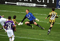 Phoenix keeper Mark Paston is beaten by Victor Sikora for Perth's goal during the A-League football match between Wellington Phoenix and Perth Glory at Westpac Stadium, Wellington, New Zealand on Sunday, 16 August 2009. Photo: Dave Lintott / lintottphoto.co.nz