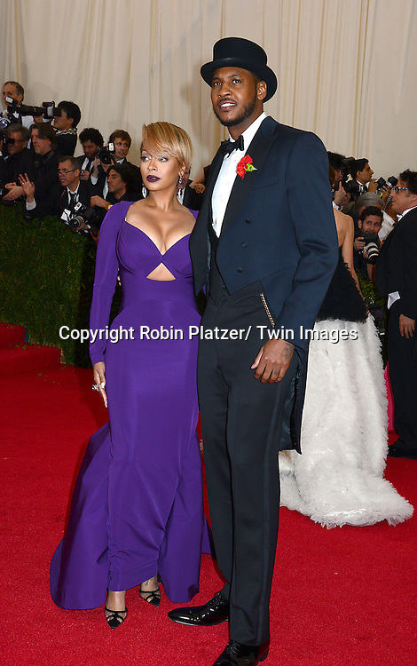 La La Anthony and Carmelo Anthony attends the Costume Institute Benefit on May 5, 2014 at the Metropolitan Museum of Art in New York City, NY, USA. The gala celebrated the opening of Charles James: Beyond Fashion and the new Anna Wintour Costume Center.