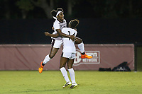 MSU freshman Zakirah McGillivary, a psychology major from Brooklyn, New York, leaps into her teammate Niah Johnson's arms after scoring the game-winning goal in MSU's Thursday [Sept. 20] soccer match against South Carolina. In front of a record crowd of 1,402 fans, the Bulldogs beat the Gamecocks 2-1 in overtime, ending USC's 24-match unbeaten streak in SEC play. With the win, the Bulldogs are now 8-1 on the season and 1-1 in SEC play. They will travel to take on the Tennessee Volunteers at 2 p.m. Sunday [Sept. 23].  <br />  (photo by Blake Williams / &copy; Mississippi State University Athletics)