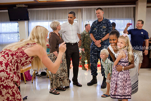 United States President Barack Obama and First Lady Michelle Obama greet service men and women and their families, during Christmas dinner in the mess hall at Marine Corps Base Hawaii in Kailua, Hawaii, December 25, 2010..Mandatory Credit: Pete Souza - White House via CNP