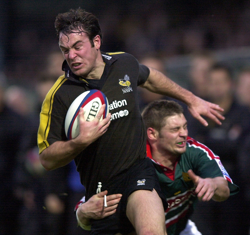 Photo. Richard Lane.London Wasps v Leicester Tigers at Adams Park. Zurich Premiership. 27/12/2002.Fraser Waters is tackled by John Holtby