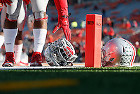 Ohio State Buckeyes running back Ezekiel Elliott (15) picks up his helmet as he warms up before the college football game between the Ohio State Buckeyes and the Illinois Fighting Illini at Memorial Stadium in Champaign, Ill., Saturday morning, November 14, 2015. (The Columbus Dispatch / Eamon Queeney)