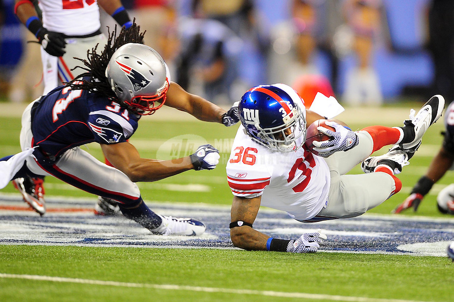 Feb 5, 2012; Indianapolis, IN, USA; New York Giants defensive back Will Blackmon (36) is tackled by New England Patriots free safety Sergio Brown (31) on a punt return during the second half of Super Bowl XLVI at Lucas Oil Stadium.  Mandatory Credit: Mark J. Rebilas-
