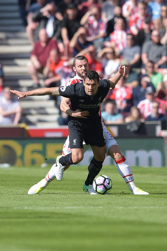 Stoke City's Erik Pieters battles with Liverpool's Dejan Lovren<br /> <br /> Photographer Terry Donnelly/CameraSport<br /> <br /> The Premier League - Stoke City v Liverpool - Saturday 8th April 2017 - bet365 Stadium - Stoke-on-Trent<br /> <br /> World Copyright &copy; 2017 CameraSport. All rights reserved. 43 Linden Ave. Countesthorpe. Leicester. England. LE8 5PG - Tel: +44 (0) 116 277 4147 - admin@camerasport.com - www.camerasport.com