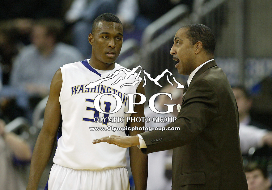 14 January 2010:  Washington Huskies head coach Lorenzo Romar instructs guard #31 Elston Turner during a timeout against Stanford. Washington won 94-61over Stanford at the Bank of America Arena in Seattle, WA.