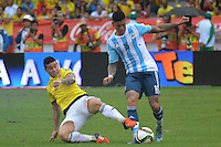 BARRANQUILLA - COLOMBIA- 17-11-2015: James Rodriguez (Izq) jugador de Colombia disputa el balón con Marcos Rojo (Der) jugador de Argentina, durante partido de la fecha 4 válido por la clasificación a la Copa Mundo FIFA 2018 Rusia jugado en el estadio Metropolitano Roberto Melendez en Barranquilla. /  James Rodriguez (L) player of Colombia vies the ball with Marcos Rojo (R) player of Argentina during match for the date 4 valid for the 2018 FIFA World Cup Russia Qualifier played at Metropolitan stadium Roberto Melendez in Barranquilla. Photo: VizzorImage / Alfonso Cervantes / Cont.