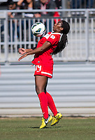Tiffany McCarty (14) of the Washington Spirit controls the ball  during the game at the Maryland SportsPlex in Boyds, MD.  The Washington Spirit defeated the North Carolina Tar Heels in a preseason exhibition, 2-0.