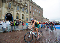 26 AUG 2012 - STOCKHOLM, SWE - Aaron Royle (AUS) of Australia  cycles past The Royal Palace during the 2012 ITU Mixed Relay Triathlon World Championships in Gamla Stan, Stockholm, Sweden (PHOTO (C) 2012 NIGEL FARROW)