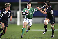 Irish centre Eoin O'Malley fends off Scottish captain Frazer McKenzie  during the Division A clash in the U19 World Championship at Ravenhill.