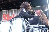 """Slipknot Performs on Ozzfest 2005 for The Subliminal Verses World Tour (2004–2005).(#6) Shawn """"Clown"""" Crahan – custom percussion, backing vocals.Photo Credit: Eddie Malluk/AtlasIcons.com"""
