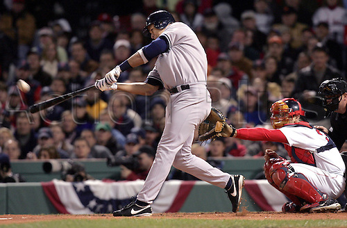 17 October 2004: New York Yankees ALEX RODRIGUEZ hits his 2-run homer in front of Red Sox catcher Jason Varitek in the third inning of Game 5 in the American League Championship series against Boston Red Sox, played at Fenway Park, Boston. The Red Sox won the game 5 - 4 in the longest game in play-off history. The Yankees lead 3-2 in the best of 7 Series Photo:  Jeff Zelevansky/Icon/Action Plus...baseball  pitch player 041017 alcs batter hitter