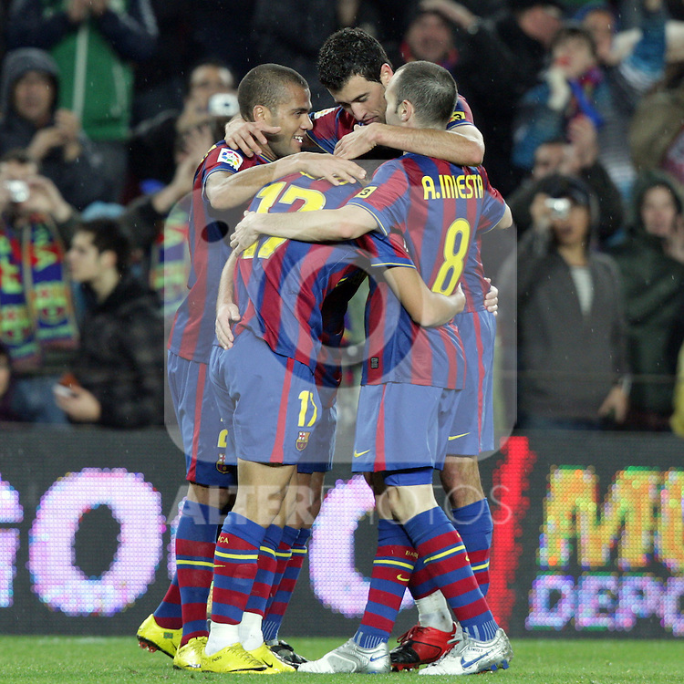 Football Season 2009-2010. Barcelona players Pedro Rodriguez, Dani Alves, Sergio Busquets and Andres Iniesta celebrating a goal during their spanish liga soccer match at Camp Nou stadium in Barcelona. January 16, 2010.