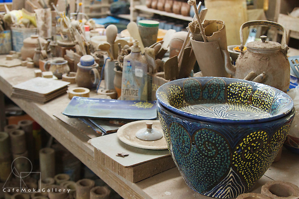 Earthworks Pottery, decorated pot and tools for making ceramics