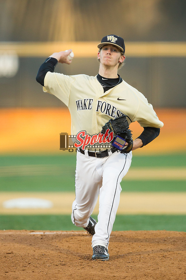 Wake Forest Demon Deacons starting pitcher Jack Fischer (15) in action against the Cincinnati Bearcats at Wake Forest Baseball Park on February 21, 2014 in Winston-Salem, North Carolina.  The Bearcats defeated the Demon Deacons 5-0.  (Brian Westerholt/Sports On Film)