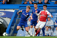 Luke McCormick of Chelsea stretches to reach the ball as Arsenal's Robbie Burton looks on during Chelsea Under-23 vs Arsenal Under-23, Premier League 2 Football at Stamford Bridge on 15th April 2019