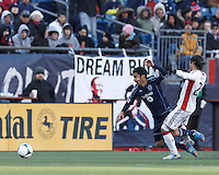 As Sporting Kansas City midfielder Paulo Nagamura (6) dribbles New England Revolution midfielder Lee Nguyen (24) defends.  In a Major League Soccer (MLS) match, Sporting Kansas City (blue) tied the New England Revolution (white), 0-0, at Gillette Stadium on March 23, 2013.