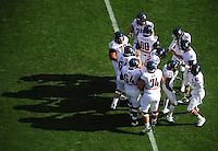 Nov. 28, 2009; Tempe, AZ, USA; Arizona Wildcats players in the huddle against the Arizona State Sun Devils at Sun Devil Stadium. Arizona defeated Arizona State 20-17. Mandatory Credit: Mark J. Rebilas-