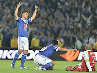 BOGOTÁ -COLOMBIA, 29-06-2013. Fredy Montero de Millonarios celebra un gol en contra de Santa Fe durante partido de los cuadrangulares finales, fecha 5, de la Liga Postobón 2013-1 jugado en el estadio el Campín de la ciudad de Bogotá./Fredy Montero of Millonarios celebrates a goal  against Santa Fe during match of the final quadrangular 5th date of Postobon  League 2013-1 at El Campin stadium in Bogotá city. Photo: VizzorImage/STR