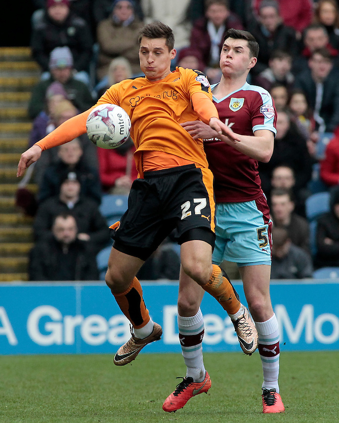 Wolverhampton Wanderers' Michael Zyro shields the ball from Burnley's Michael Keane<br /> <br /> Photographer David Shipman/CameraSport<br /> <br /> Football - The Football League Sky Bet Championship - Burnley v Wolverhampton Wanderers - Saturday 19th March 2016 - Turf Moor - Burnley<br /> <br /> &copy; CameraSport - 43 Linden Ave. Countesthorpe. Leicester. England. LE8 5PG - Tel: +44 (0) 116 277 4147 - admin@camerasport.com - www.camerasport.com
